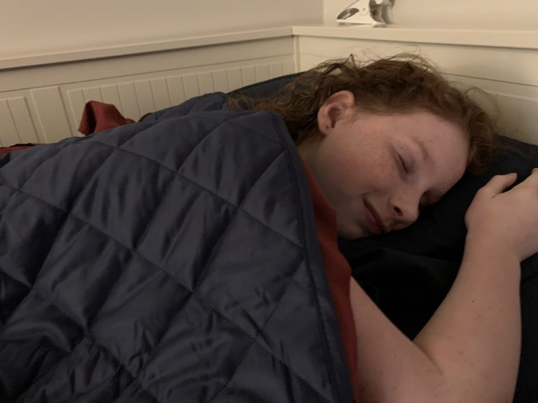 kid sleeping with weighted blanket