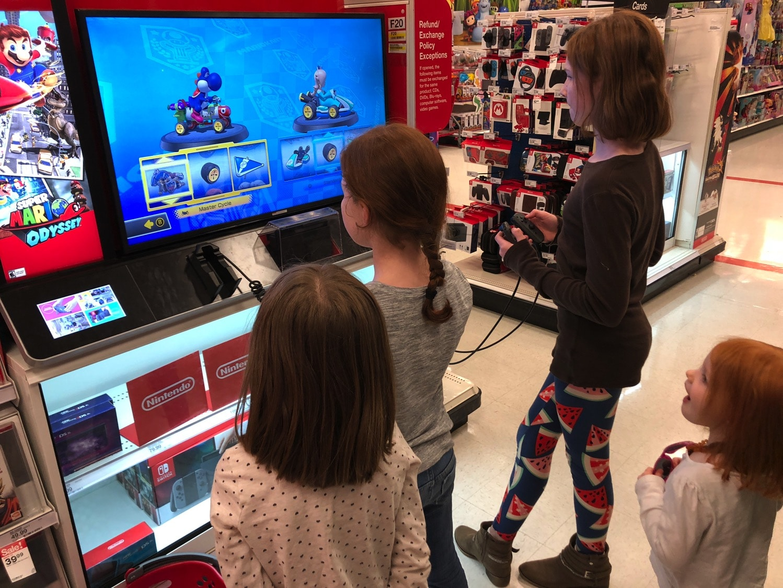 girls playing nintendo switch at target