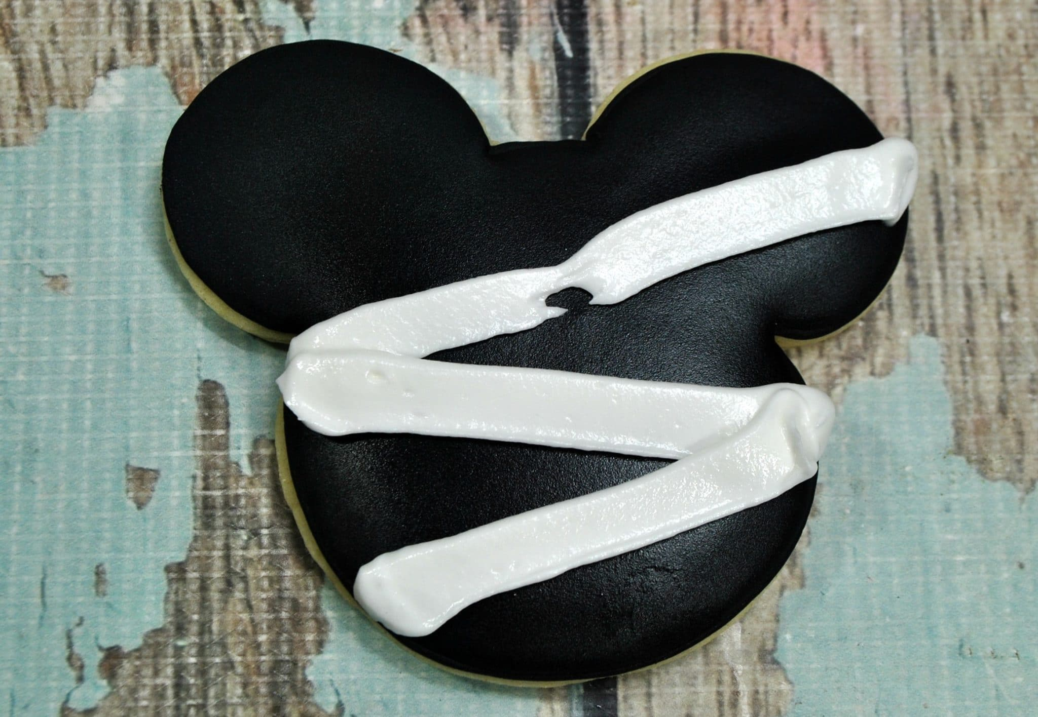 Mickey Mummy Cookie with mummy bands starting to apply