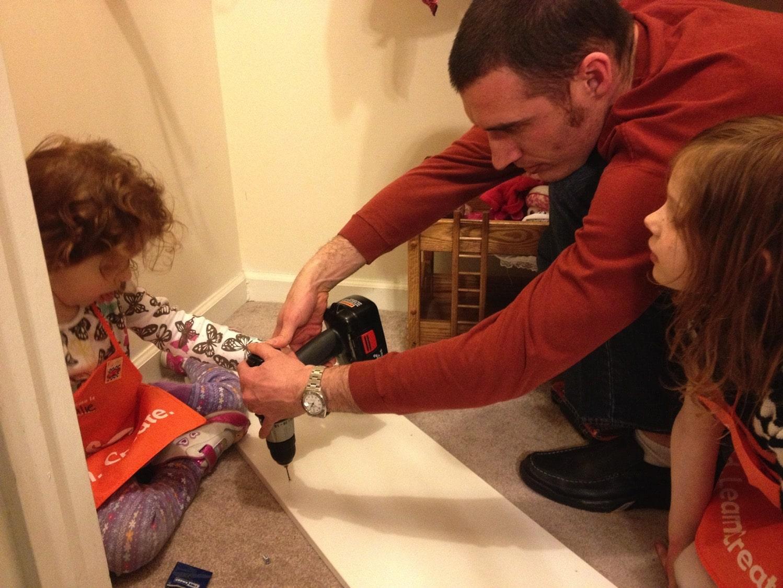 Helping daddy build closet