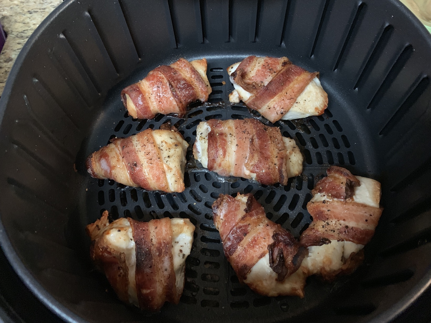 cooked bacon wrapped chicken in the newair air fryer
