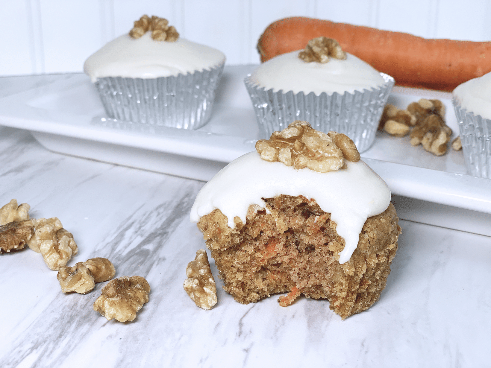 Gluten free dairy free carrot cake cupcake with dairy free cream cheese icing