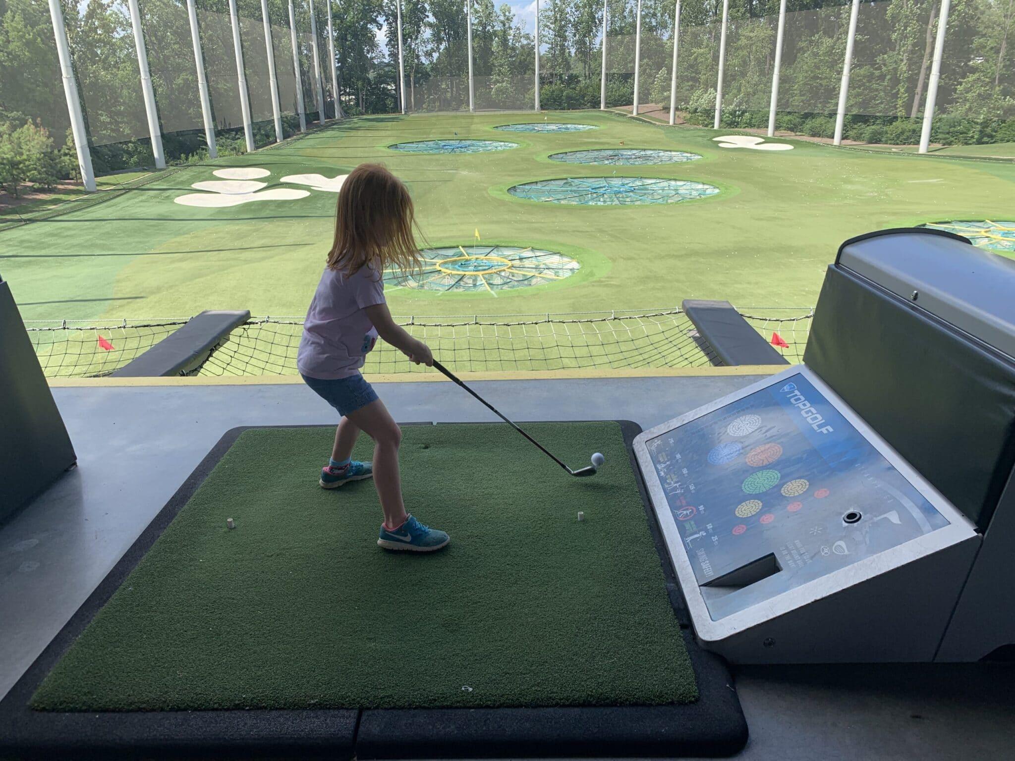 kid golfing at topgolf