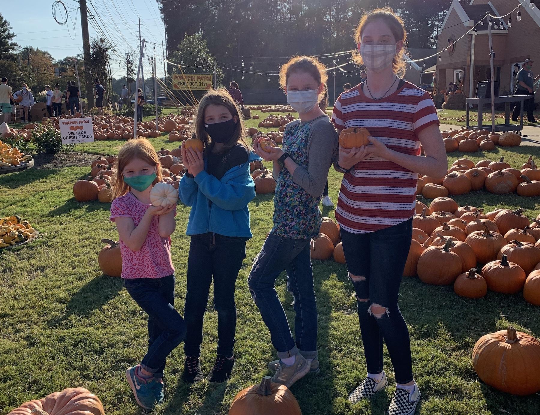 pumpkin patch girls standing