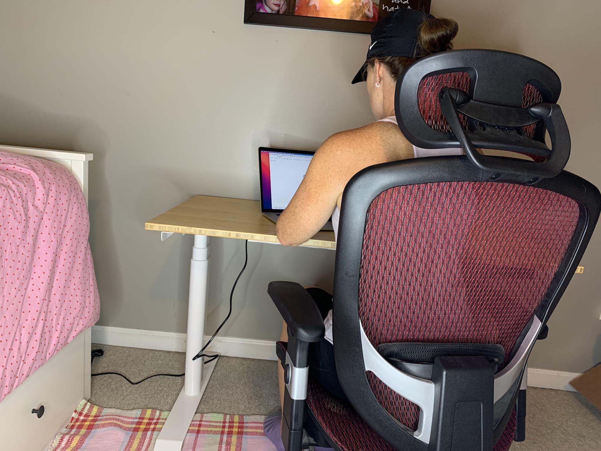 sitting-at-flexispot-bamboo-pro-desk-1